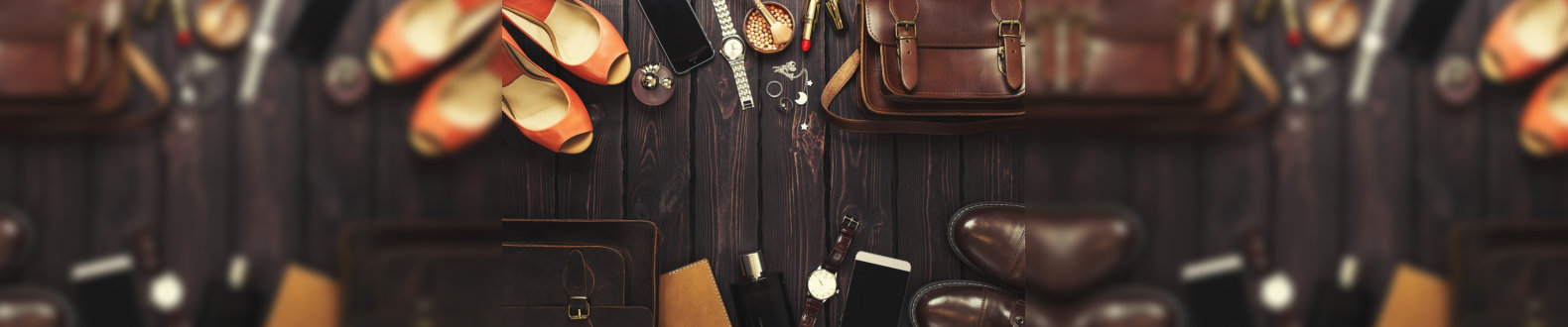 Top view, fashionable male and female personal items with space on a dark wooden background.